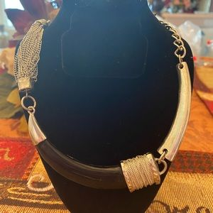 Silvertone and black enamel horn necklace